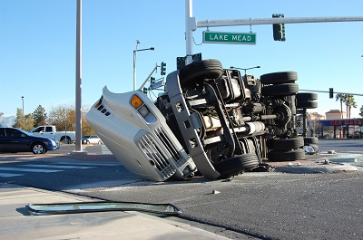 image of big rig overturned in an intersection