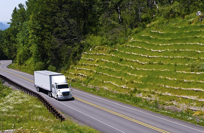 Truck Driving on Hilly Road